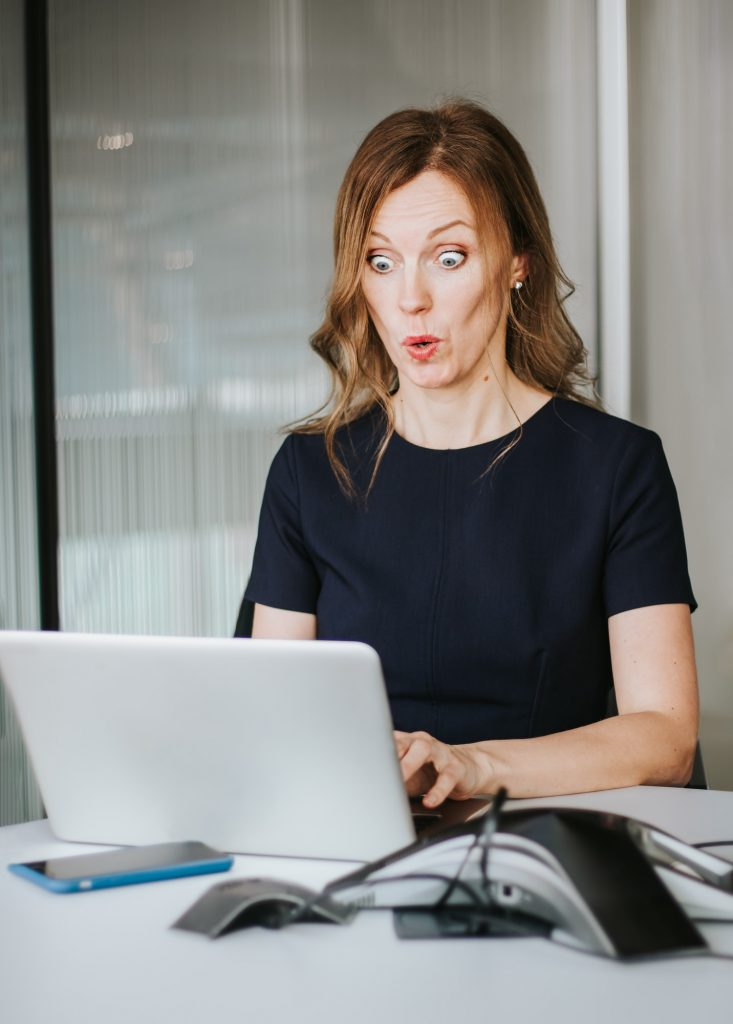 Portrait of modern beautiful business woman with funny surprised face expression and big eyes